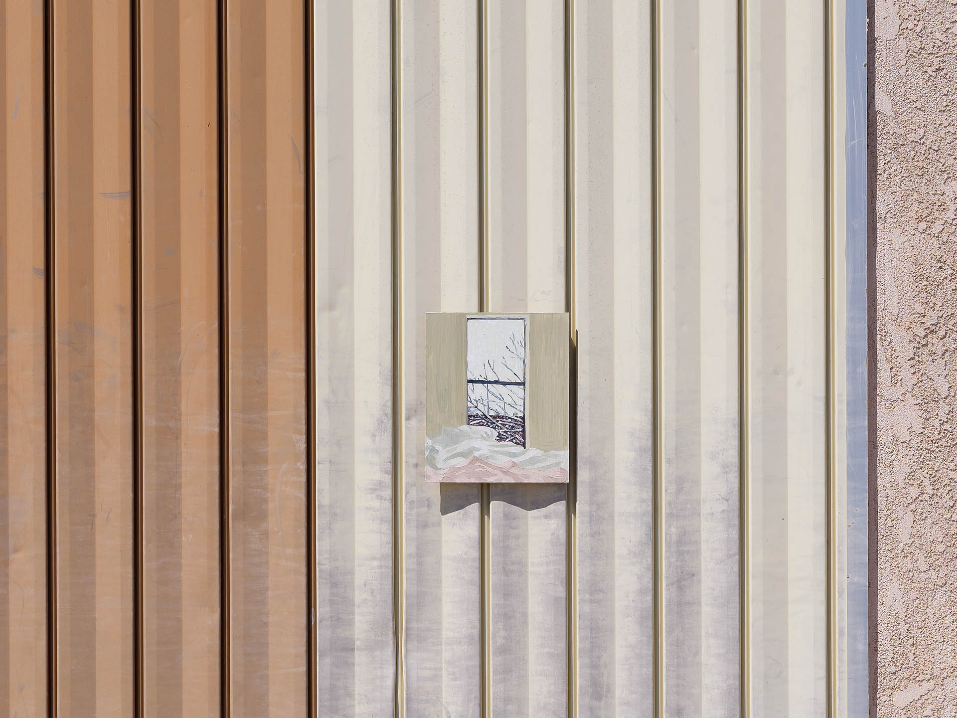 An installation view of Claudia Keep's painting, 9:07 AM, captured by photographer Tag Christof in the Western United States in 2021 for MARCH. The image shows a painting hung outside on a pink facade.
