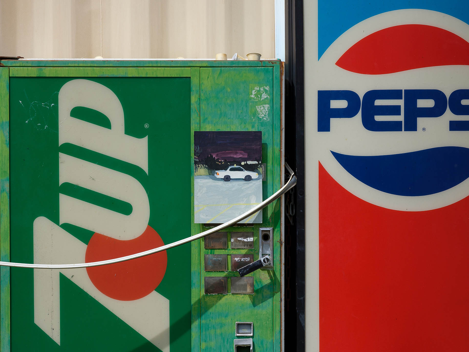 An installation view of Claudia Keep's painting, Bangor, 10:32 PM, captured by photographer Tag Christof in the Western United States in 2021 for MARCH. The image shows a painting hung outside on a 7Up vending machine.